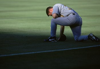 4 Sep 2000: Warren Morris #30 of the Pittsburgh Pirates kneels on the field during the game against the Los Angeles Dodgers at Dodger Stadium in Los Angeles, California. The Pirates defeated the Dodgers 12-1.Mandatory Credit: Jeff Gross  /Allsport