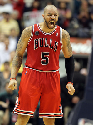 INDIANAPOLIS, IN - APRIL 21:  Carlos Boozer #5 of the Chicago Bulls celebrates after Derrick Rose hit the game winning shot against the Indiana Pacers in Game three of the Eastern Conference Quarterfinals in the 2011 NBA Playoffs on April 21, 2011  at Con