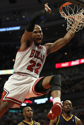 CHICAGO, IL - MARCH 07: Taj Gibson #22 of the Chicago Bulls celebrates a dunk against the New Orleans Hornets at the United Center on March 7, 2011 in Chicago, Illinois. The Bulls defeated the Hornets 85-77. NOTE TO USER: User expressly acknowledges and a