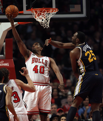 CHICAGO, IL - MARCH 12: Kurt Thomas #40 of the Chicago Bulls puts up a shot under pressure from Al Jefferson #25 of the Utah Jazz at the United Center on March 12, 2011 in Chicago, Illinois. NOTE TO USER: User expressly acknowledges and agrees that, by do