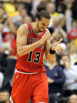 INDIANAPOLIS, IN - APRIL 21:  Joakim Noah #13 of the Chicago Bulls celebrates after Derrick Rose hit the game winning shot against the Indiana Pacers in Game three of the Eastern Conference Quarterfinals in the 2011 NBA Playoffs on April 21, 2011  at Cons