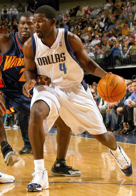 DALLAS - DECEMBER 14: Forward Michael Finley #4 of the Dallas Mavericks moves the ball past Jason Richardson #23 of the Golden State Warriors on December 14, 2004 at the American Airlines Center in Dallas, Texas.   NOTE TO USER:  User expressly acknowledg