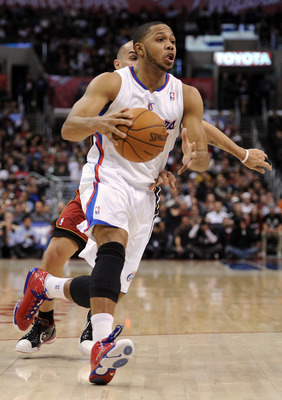 LOS ANGELES, CA - JANUARY 12:  Eric Gordon #10 of the Los Angeles Clippers heads to the basket in front of Carlos Arroyo #8 of the Miami Heat at Staples Center on January 12, 2011 in Los Angeles, California.  NOTE TO USER: User expressly acknowledges and