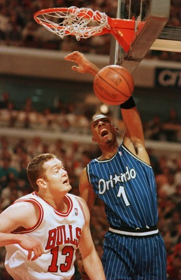 19 May 1996: Forward Anfernee ''Penny'' Hardaway #1 of the Orlando Magic dunks the ball over Center Luc Longley #13 of the Chicago Bulls during first quarter action of game one of the Eastern Conference Championships at the United Center in Chicago, Illin