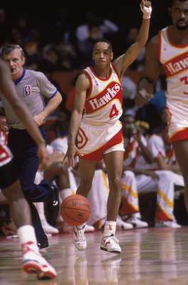 CHICAGO - 1989:  Spud Webb #4 of the Atlanta Hawks dribbles the ball during a NBA game against the Chicago Bulls at Chicago Stadium in Chicago, Illinois in 1989.  (Photo by Rick Stewart/Getty Images)