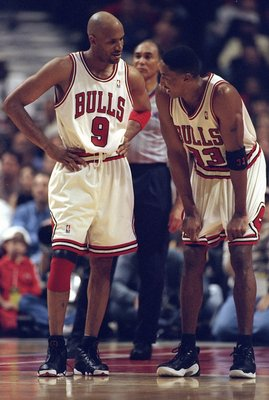 3 May 1998: Ron Harper #9 talks with Scottie Pippen #33 of the Chicago Bulls during the NBA Playoffs round 1 game against the Charlotte Hornets at the United Center in Chicago, Illinois. The Bulls defeated the Hornets 83-70.