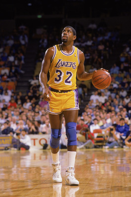 LOS ANGELES - 1988:  Magic Johnson #32 of the Los Angeles Lakers dribbles the ball during an NBA game at the Great Western Forum in Los Angeles, California in 1988. (Photo by: Mike Powell/Getty Images)