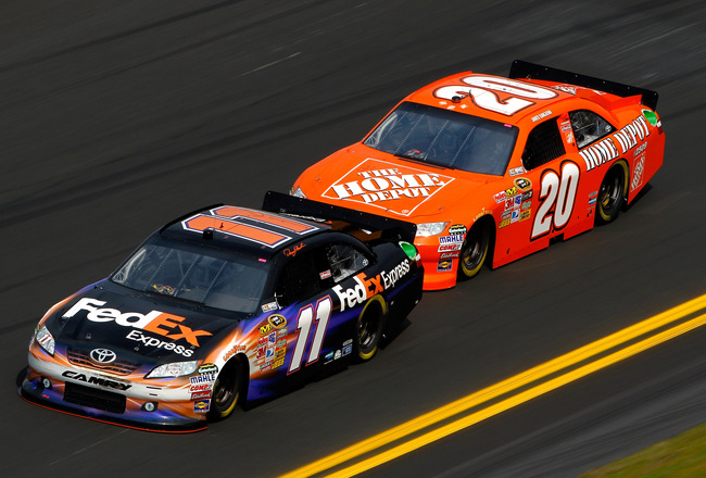 DAYTONA BEACH, FL - FEBRUARY 16:  Denny Hamlin, driver of the #11 FedEx Toyota, leads Joey Logano, driver of the #20 Home Depot Toyota, during practice for the NASCAR Sprint Cup Series Daytona 500 at Daytona International Speedway on February 16, 2011 in