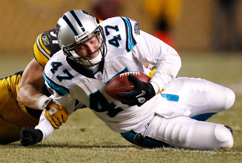 PITTSBURGH - DECEMBER 23:  Jeff King #47 of the Carolina Panthers is tackled after catching a pass during the game against the Pittsburgh Steelers on December 23, 2010 at Heinz Field in Pittsburgh, Pennsylvania.  (Photo by Jared Wickerham/Getty Images)