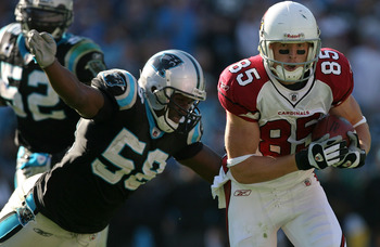 CHARLOTTE, NC - OCTOBER 26:  Jerheme Urban #85 of the Arizona Cardinals tries to run away from Thomas Davis #58 of the Carolina Panthers during their game  on October 26, 2008 at Bank of America Stadium in Charlotte, North Carolina.  (Photo by Streeter Le