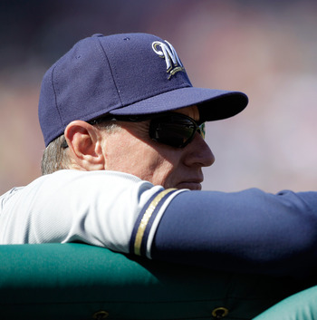 WASHINGTON, DC - APRIL 17: Manager  Ron Roenicke #10 of the Milwaukee Brewers looks on from the dugout against the Washington Nationals during the first game of a doubleheader at Nationals Park on April 17, 2011 in Washington, DC.  (Photo by Rob Carr/Gett