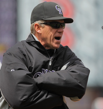 DENVER, CO - APRIL 20:  Manager Jim Tracy (L) of the Colorado Rockies protests a call by firstbase umpire Ed Hickox when he called Aubrey Huff of the San Francisco Giants safe at first on an attempted double play at Coors Field on April 20, 2011 in Denver