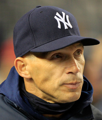 NEW YORK, NY - APRIL 15: Manager Joe Girardi of the New York Yankees looks on from the dugout during the game against the Texas Rangers at Yankee Stadium on April 15, 2011 in the Bronx borough of New York City.  (Photo by Chris Trotman/Getty Images)