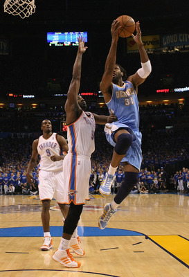 OKLAHOMA CITY, OK - APRIL 17: Nene #31 of the Denver Nuggets drives to the basket against Kendrick Perkins #5 of the Oklahoma City Thunder in Game One of the Western Conference Quarterfinals in the 2011 NBA Playoffs on April 17, 2011 at the Ford Center in