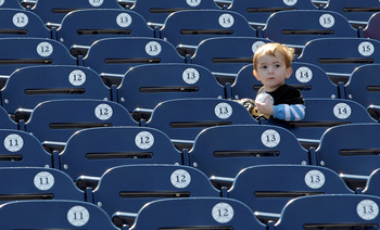 WASHINGTON, DC - APRIL 17:  A young baseball fan waits to get autographs before the start of the Milwaukee Brewers and Washington Nationals game at Nationals Park on April 17, 2011 in Washington, DC.  (Photo by Rob Carr/Getty Images)