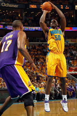 NEW ORLEANS, LA - APRIL 22:  Emeka Okafor #50  of the New Orleans Hornets shoots the ball over Andrew Bynum #17 of the Los Angeles Lakers in Game Three of the Western Conference Quarterfinals in the 2011 NBA Playoffs at the New Orleans Arena  on April 22,