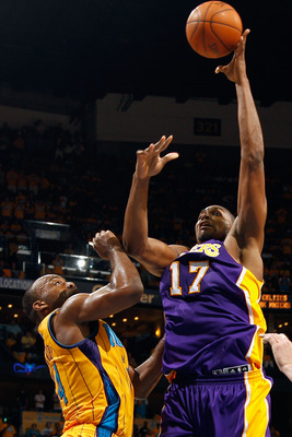 NEW ORLEANS, LA - APRIL 22:  Andrew Bynum #17 of the Los Angeles Lakers shoots the ball over Marco Belinelli #8 of the New Orleans Hornets in Game Three of the Western Conference Quarterfinals in the 2011 NBA Playoffs at the New Orleans Arena  on April 22