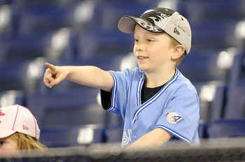 TORONTO,CANADA - APRIL 1:  A young fan points to players on the field prior to the home opener for the Toronto Blue Jays as they face the Minnesota Twins during their MLB game at the Rogers Centre April 1, 2011 in Toronto, Ontario, Canada.(Photo By Dave S