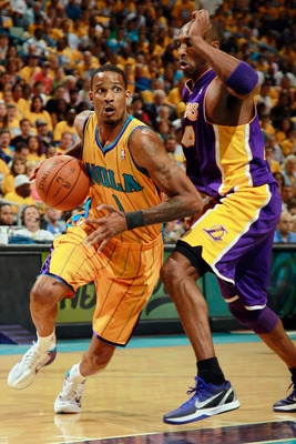 NEW ORLEANS, LA - APRIL 22:  Trevor Ariza #1 of the New Orleans Hornets drives the ball around Kobe Bryant #24  of the Los Angeles Lakers in Game Three of the Western Conference Quarterfinals in the 2011 NBA Playoffs at the New Orleans Arena  on April 22,