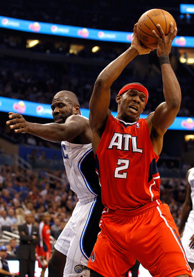 ORLANDO, FL - APRIL 19:  Joe Johnson #2 of the Atlanta Hawks rebounds against the Orlando Magic during Game Two of the Eastern Conference Quarterfinals of the 2011 NBA Playoffs on April 19, 2011 at the Amway Arena in Orlando, Florida.  NOTE TO USER: User