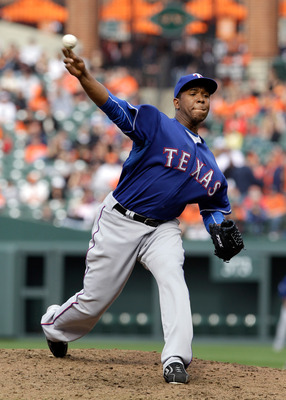 BALTIMORE, MD - APRIL 10: Relief pitcher Neftali Feliz #30 of the Texas Rangers delivers to a Baltimore Orioles batter during the ninth inning at Oriole Park at Camden Yards on April 10, 2011 in Baltimore, Maryland.  (Photo by Rob Carr/Getty Images)
