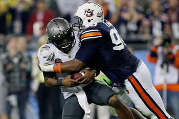 GLENDALE, AZ - JANUARY 10:  Quarterback Darron Thomas #1 of the Oregon Ducks is sacked by Nick Fairley #90 of the Auburn Tigers in the first half in the Tostitos BCS National Championship Game at University of Phoenix Stadium on January 10, 2011 in Glenda