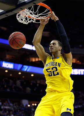 CHARLOTTE, NC - MARCH 20:  Jordan Morgan #52 of the Michigan Wolverines dunks the ball while taking on the Duke Blue Devils during the third round of the 2011 NCAA men's basketball tournament at Time Warner Cable Arena on March 20, 2011 in Charlotte, Nort