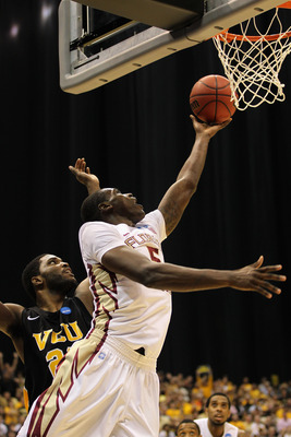 SAN ANTONIO, TX - MARCH 25:  Bernard James #5 of the Florida State Seminoles goes to the basket against Jamie Skeen #21 of the Virginia Commonwealth Rams during the southwest regional of the 2011 NCAA men's basketball tournament at the Alamodome on March