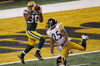 ARLINGTON, TX - FEBRUARY 06:  Greg Jennings #85 of the Green Bay Packers catches a 21 yard touchdown pass against the Pittsburgh Steelers during the second quarter of Super Bowl XLV at Cowboys Stadium on February 6, 2011 in Arlington, Texas.  (Photo by Jo