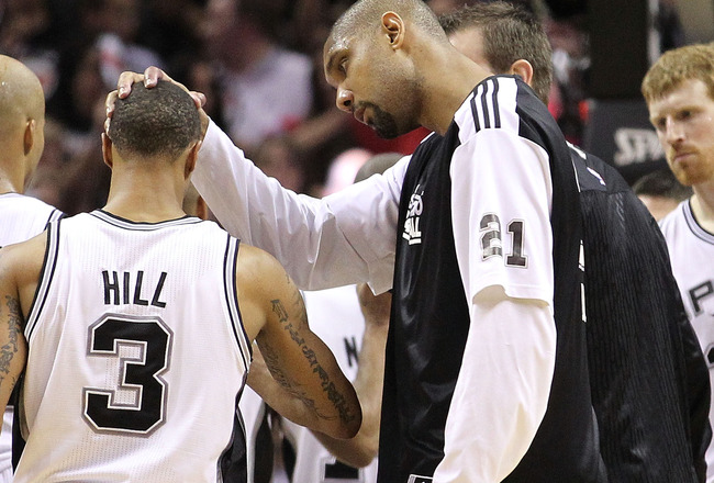 SAN ANTONIO, TX - APRIL 20:  Tim Duncan #21 pats the head of George Hill #3 of the San Antonio Spurs after a win against the Memphis Grizzlies in Game Two of the Western Conference Quarterfinals in the 2011 NBA Playoffs on April 20, 2011 at AT&T Center in