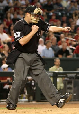 PHOENIX - JULY 23:  Home plate umpire Todd Tichenor calls strike three during the major league baseball game between the Pittsburgh Pirates and the Arizona Diamondbacks at Chase Field on July 23, 2009 in Phoenix, Arizona.  The Diamondbacks defeated the Pi