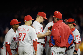WASHINGTON, DC - APRIL 12: Starting pitcher Joe Blanton #56 of the Philadelphia Phillies (C) talks with pitching coach Rich Dubee (R) during the fourth inning against the Washington Nationals at Nationals Park on April 12, 2011 in Washington, DC. (Photo b