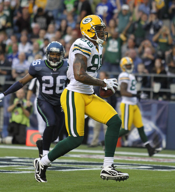 SEATTLE - AUGUST 21:  Tight end Jermichael Finley #88 of the Green Bay Packers scores a touchdown during the preseason game against Josh Wilson #26 of the Seattle Seahawks at Qwest Field on August 21, 2010 in Seattle, Washington. (Photo by Otto Greule Jr/