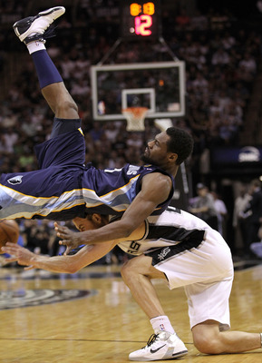 SAN ANTONIO, TX - APRIL 20:  Guard Tony Allen #9 of the Memphis Grizzlies falls on top of Manu Ginobili #20 of the San Antonio Spurs in Game Two of the Western Conference Quarterfinals in the 2011 NBA Playoffs on April 20, 2011 at AT&T Center in San Anton