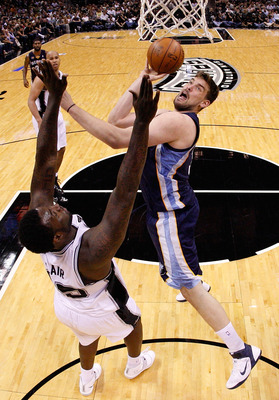 SAN ANTONIO, TX - APRIL 17:  Center Marc Gasol #33 of the Memphis Grizzlies takes a shot against DeJuan Blair #45 of the San Antonio Spurs in Game One of the Western Conference Quarterfinals in the 2011 NBA Playoffs on April 17, 2011 at AT&T Center in San