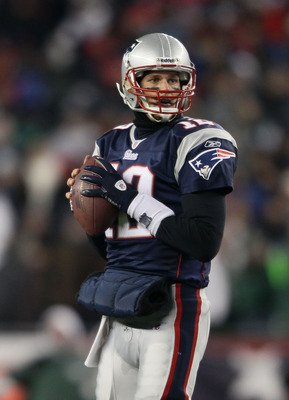 FOXBORO, MA - JANUARY 16:  Quarterback Tom Brady #12 of the New England Patriots looks to pass during their 2011 AFC divisional playoff game against the New York Jets at Gillette Stadium on January 16, 2011 in Foxboro, Massachusetts.  (Photo by Elsa/Getty