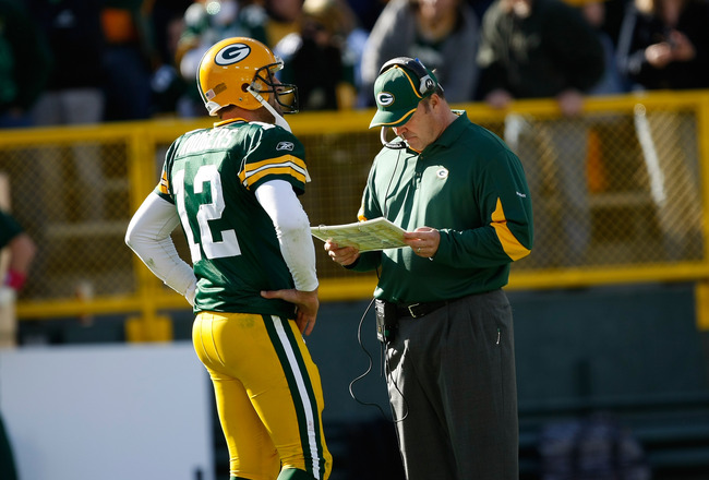 GREEN BAY, WI - OCTOBER 17: Aaron Rogers #12 of the Green Bay Packers talks with Mike McCarthy against the Miami Dolphins at Lambeau Field on October 17, 2010 in Green Bay, Wisconsin. The Dolphins defeated the Packers 23-20 in overtime. (Photo by Scott Bo
