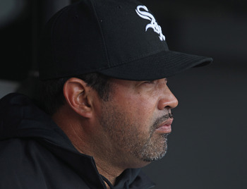 CHICAGO, IL - APRIL 07: Manager Ozzie Guillen #13 of the Chicago White Sox sits in the dugout before the home opener against the Tampa Bay Rays at U.S. Cellular Field on April 7, 2011 in Chicago, Illinois. The White Sox defeated the Rays 5-1. (Photo by Jo