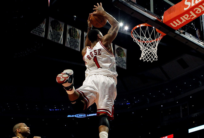 CHICAGO - FEBRUARY 24: Derrick Rose #1 of the Chicago Bulls takes a pass and leaps to dunk the ball against the Indiana Pacers at the United Center on February 24, 2010 in Chicago, Illinois. The Bulls defeated the Pacers 120-110. NOTE TO USER: User expres