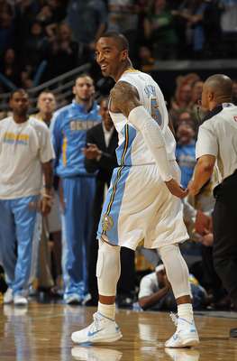 DENVER, CO - MARCH 23:  J.R. Smith #5 of the Denver Nuggets celebrates after scoring against the San Antonio Spurs to give the Nuggets their first lead of the game 99-98 in the fourth quarter at the Pepsi Center on March 23, 2011 in Denver, Colorado. The