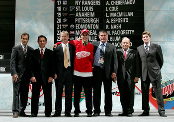 COLUMBUS, OH - JUNE 22:  27th overall pick Brendan Smith of the Detroit Red Wings poses with team personal after being drafted in the first round of the 2007 NHL Entry Draft at Nationwide Arena on June 22, 2007 in Columbus, Ohio.  (Photo by Bruce Bennett/