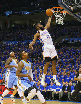 OKLAHOMA CITY, OK - APRIL 20: James Harden #13 of the Oklahoma City Thunder dunks the ball against J.R. Smith #5 of the Denver Nuggets in Game Two of the Western Conference Quarterfinals in the 2011 NBA Playoffs on April 20, 2011 at the Ford Center in Okl