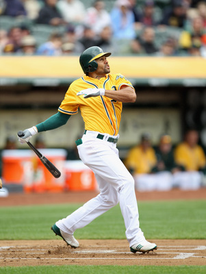 OAKLAND, CA - APRIL 20:  Coco Crisp #4 of the Oakland Athletics hits a lead off home run against the Boston Red Sox at Oakland-Alameda County Coliseum on April 20, 2011 in Oakland, California.  (Photo by Ezra Shaw/Getty Images)