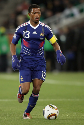 POLOKWANE, SOUTH AFRICA - JUNE 17:  Patrice Evra of France runs with the ball during the 2010 FIFA World Cup South Africa Group A match between France and Mexico at the Peter Mokaba Stadium on June 17, 2010 in Polokwane, South Africa.  (Photo by Christof