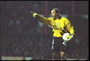 19 JAN 1994:  BRUCE GROBBELAAR OF LIVERPOOL DIRECTS HIS DEFENCE DURING THEIR FA CUP THIRD ROUND REPLAY AGAINST BRISTOL CITY AT ANFIELD. LIVERPOOL LOST THE MATCH 1-0, THIS RESULT WAS THEIR FIRST LOSS IN 13 GAMES AND IT LEAD TO THE RESIGNATION OF BOSS GRAEM