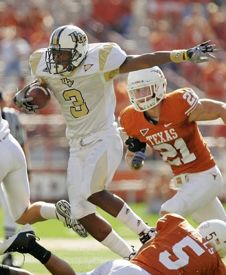 AUSTIN, TX - NOVEMBER 07:  Safety Ben Wells #5 of the Texas Longhorns tackles wide receiver A.J. Guyton #3 of the UCF Knights on November 7, 2009 at Darrell K Royal - Texas Memorial Stadium in Austin, Texas.  Texas won 35-3.  (Photo by Brian Bahr/Getty Im