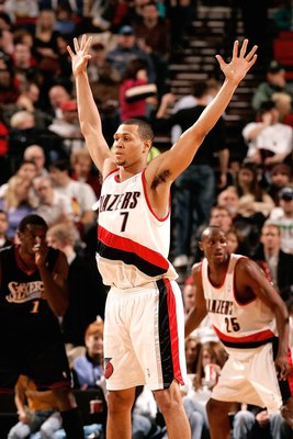 PORTLAND, OR - DECEMBER 29:  Brandon Roy #7 of the Portland Trail Blazers defendsl against the Philadelphia 76ers on December 29, 2006 at the Rose Garden in Portland, Oregon.  NOTE TO USER: User expressly acknowledges and agrees that, by downloading and o