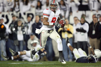 STATE COLLEGE, PA - NOVEMBER 7: Wide receiver DeVier Posey #8 of the Ohio State Buckeyes catches a 62 yard touchdown pass during a game against the Penn State Nittany Lions on November 7, 2009 at Beaver Stadium in State College, Pennsylvania. Ohio State w