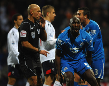 BOLTON, ENGLAND - NOVEMBER 20: Sol Campbell of Newcastle reacts to Referee Howard Webb as he awards a last minute penalty during the Barclays Premier League match between Bolton Wanderers and Newcastle United at the Reebok Stadium on November 20, 2010 in