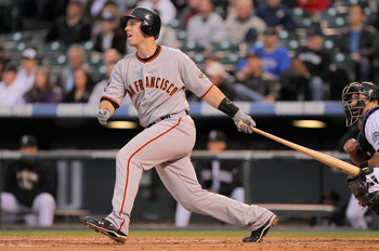 DENVER, CO - APRIL 19:  Buster Posey #28 of the San Francisco Giants takes an at bat against the Colorado Rockies at Coors Field on April 19, 2011 in Denver, Colorado.  (Photo by Doug Pensinger/Getty Images)